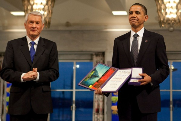 Nobel Committee Chairman Thorbjorn Jagland presents President Barack Obama with the Nobel Prize medal and diploma during the Nobel Peace Prize ceremony in Raadhuset Main Hall at Oslo City Hall in Oslo, Norway, Dec. 10, 2009. (Official White House Photo by Samantha Appleton)  This official White House photograph is being made available only for publication by news organizations and/or for personal use printing by the subject(s) of the photograph. The photograph may not be manipulated in any way and may not be used in commercial or political materials, advertisements, emails, products, promotions that in any way suggests approval or endorsement of the President, the First Family, or the White House.